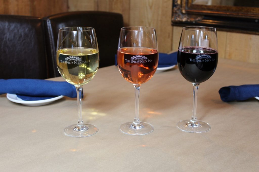 3 glasses of wine - white, rose and red in glasses on the table